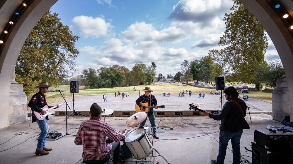 <p>Andy Ruff and the Dew Daddies perform Oct. 18 in the Otis Park Bandshell in Bedford, Indiana. Ruff&#x27;s 22-year-old son Hank, left, took turns singing lead with him and played lead guitar for the duration of the show.</p>