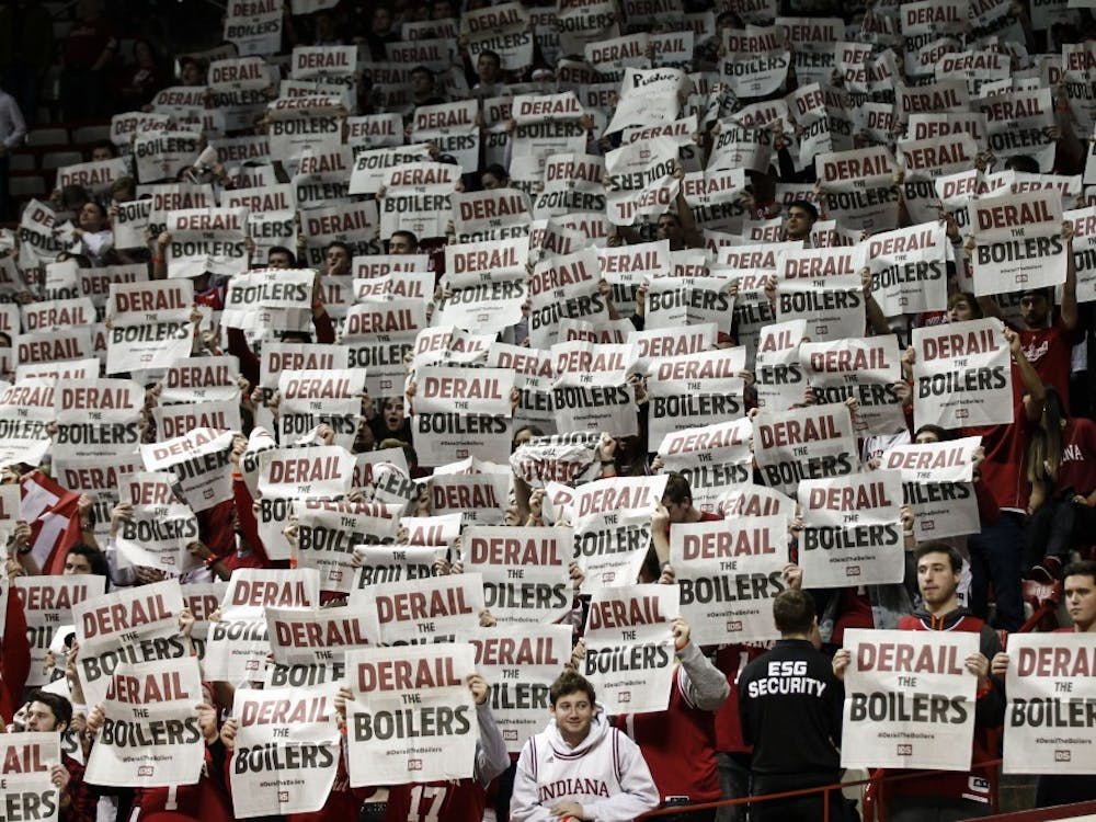 """IU students hold up """"Derail the Boilers"""" spirit pages from the Indiana Daily Student while booing Purdue University on Feb. 19 at Simon Skjodt Assembly Hall. IU lost to Purdue, 48-46."""