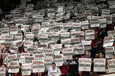 "IU students hold up ""Derail the Boilers"" spirit pages from the Indiana Daily Student while booing Purdue University on Feb. 19 at Simon Skjodt Assembly Hall. IU lost to Purdue, 48-46."