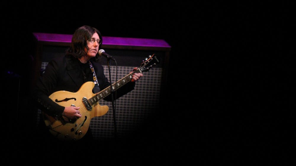 Mark Bloor, portraying John Lennon, plays the guitar with the Mersey Beatles on Oct. 12, 2018, at the Buskirk-Chumley Theater. The band will return to Bloomington for a performance at 7 p.m. Oct. 16 at the Buskirk-Chumley.