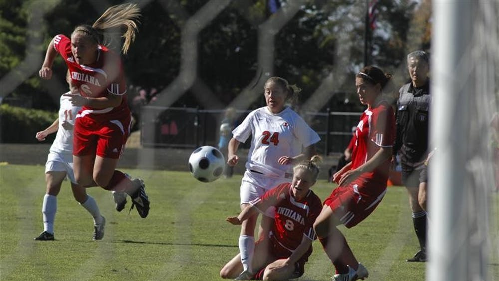 IU defenders Kelly Lawrence, Kerri Krawczak and Kirsta Kellin attempt to catch a loose ball during Indiana's 1-0 victory over Illinois on Sunday at Bill Armstrong Stadium.