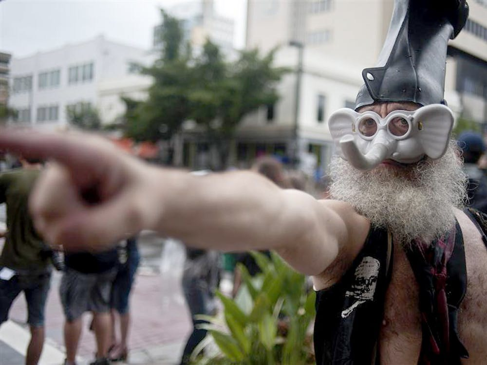 Presidential hopeful Vermin Supreme talks to protesters on Aug. 27, 2012 outside the Republican National Convention in Tampa Bay, Florida.