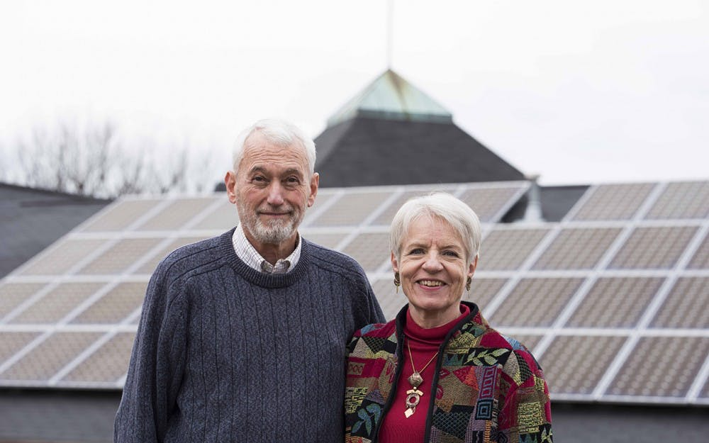 Darrel Boggess and his wife stand in front of St.Thomas Lutheran Church on East 3rd Street. The price of powering the church went from $5000 a month to $1000 after Darrel's initiative to add solar panels.