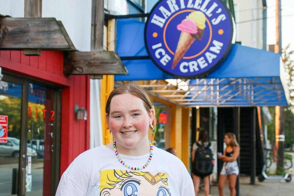 <p>Hartzell's Ice Cream employee Camryn Schneidau stands in front of the shop Sept. 1, 2021. Schneidau has worked at Hartzell&#x27;s since January 2020. </p>