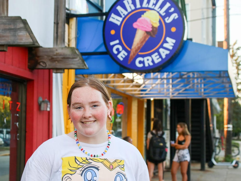 Hartzell's Ice Cream employee Camryn Schneidau stands in front of the shop Sept. 1, 2021. Schneidau has worked at Hartzell's since January 2020.
