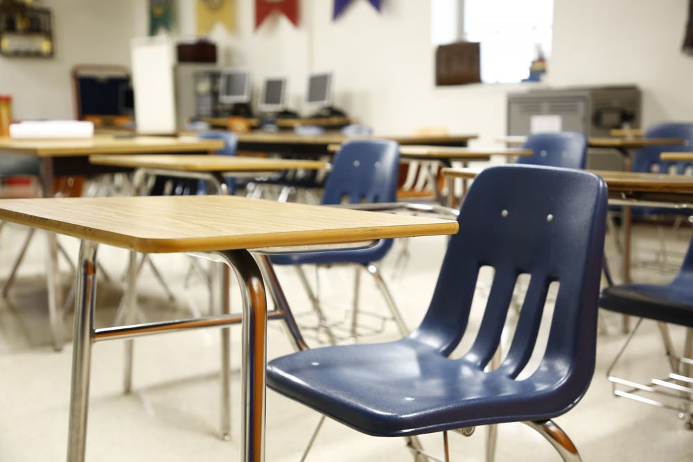 <p>An empty classroom is pictured.</p>