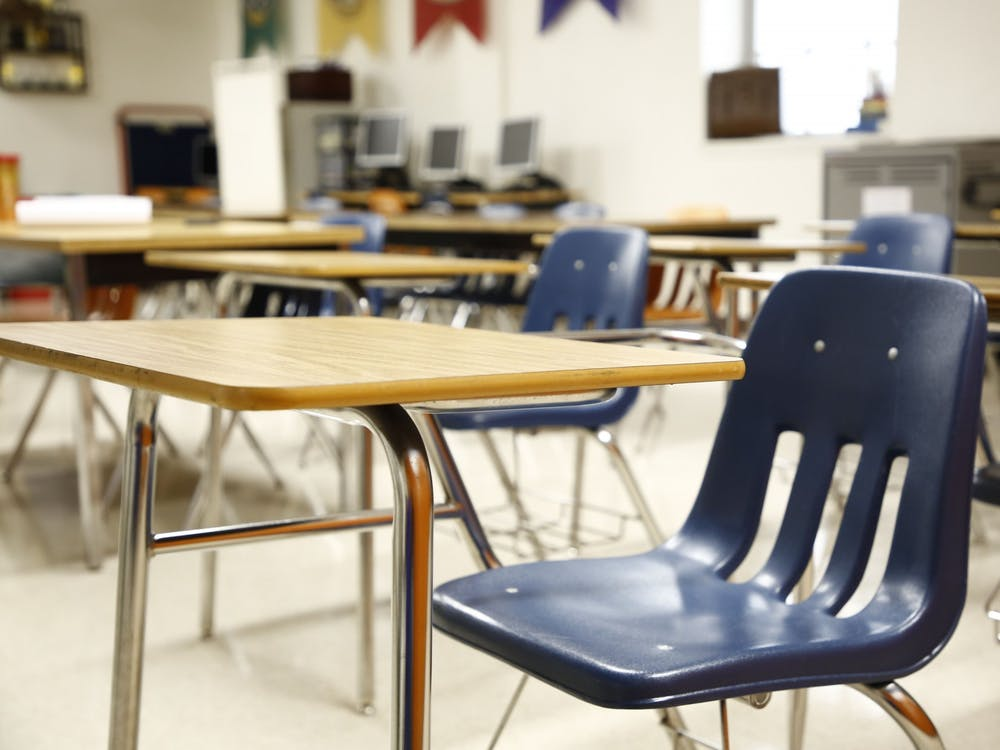 An empty classroom is pictured.