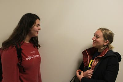 Freshman Hannah Glazier and sophomore Molly Kral talk March 20 in Franklin Hall.
