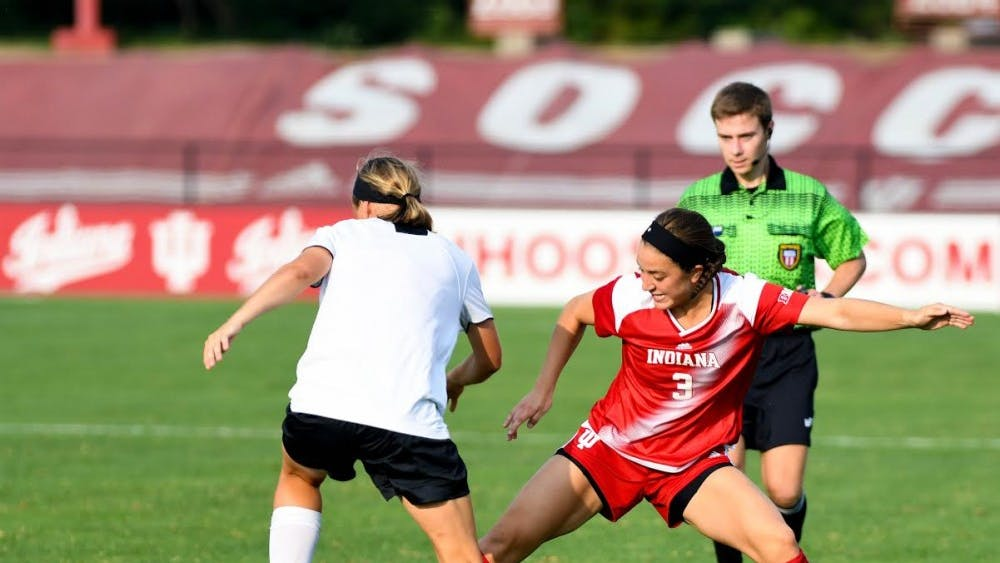 Junior forward Abby Allen tries to steal the ball from a Cincinnati player during an exhibition match at Bill Armstrong Stadium on August 11. Cincinnati defeated IU, 3-1.
