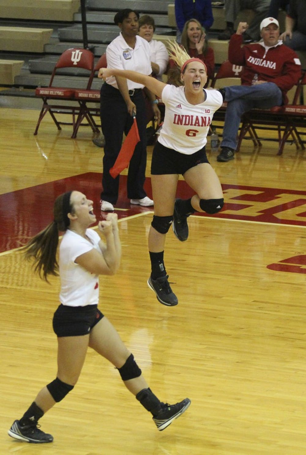 Senior defensive specialist Kyndall Merritt (left) and junior outside hitter Taylor Lebo (right) scream after the Hoosiers score a point on Saturday evening at the University Gym. Hoosiers fall 3 sets to 0 to No. 8 Nebrashka.