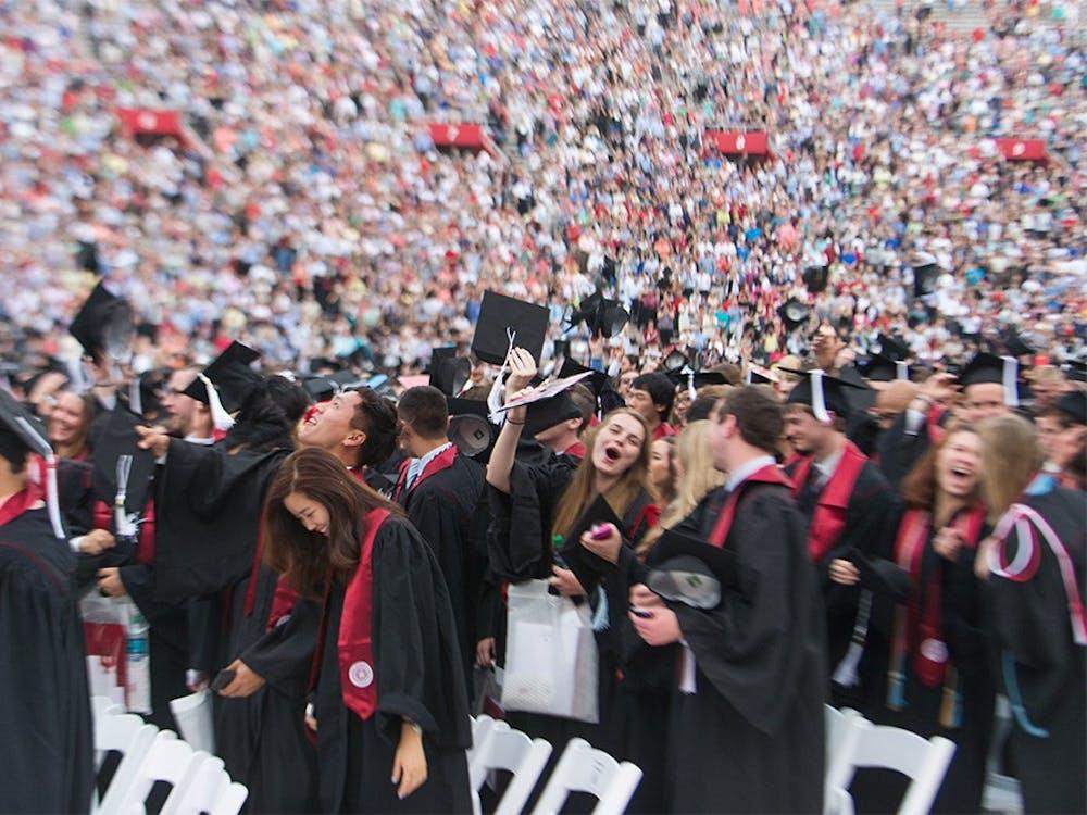 Undergraduates from School of Arts and Sciences celebrate their graduation in Memorial Stadium during the Undergraduate Commencement on Saturday.