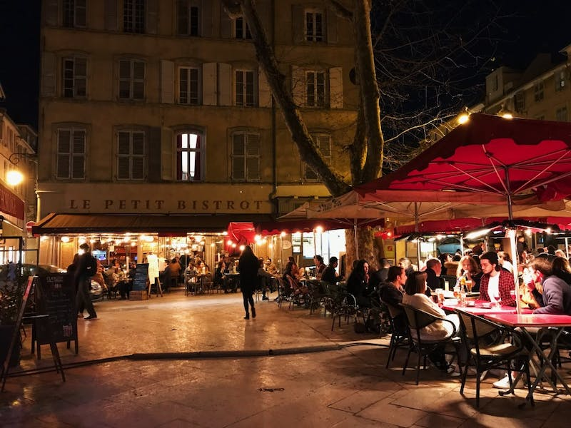 The outdoor cafe Le Petit Bistrot is in full swing March 28 in the Place des Ausgistines in Aix-en-Provence, France.