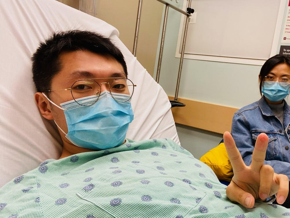 Masters student Yi Jia and his wife Shiqiao Wang wait for Yi Jia's test results Oct. 18, 2020, in the IU Health Bloomington Hospital Emergency Room. Yi Jia went to the emergency room for a fever and abdominal pain when he was diagnosed with stage four colon cancer.