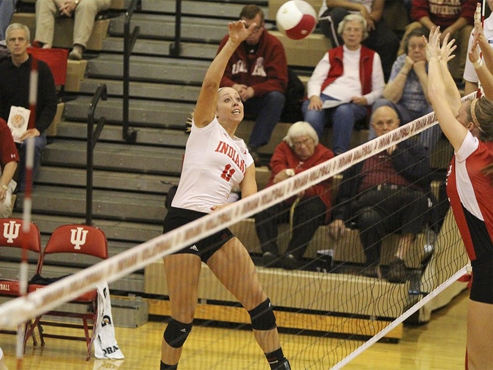 Junior Outside Hitter Allison Hammond trys to hit the ball against No. Nebraska on Saturday evening at the University Gym. No.11 Allison hammond registered nine kills for the night.