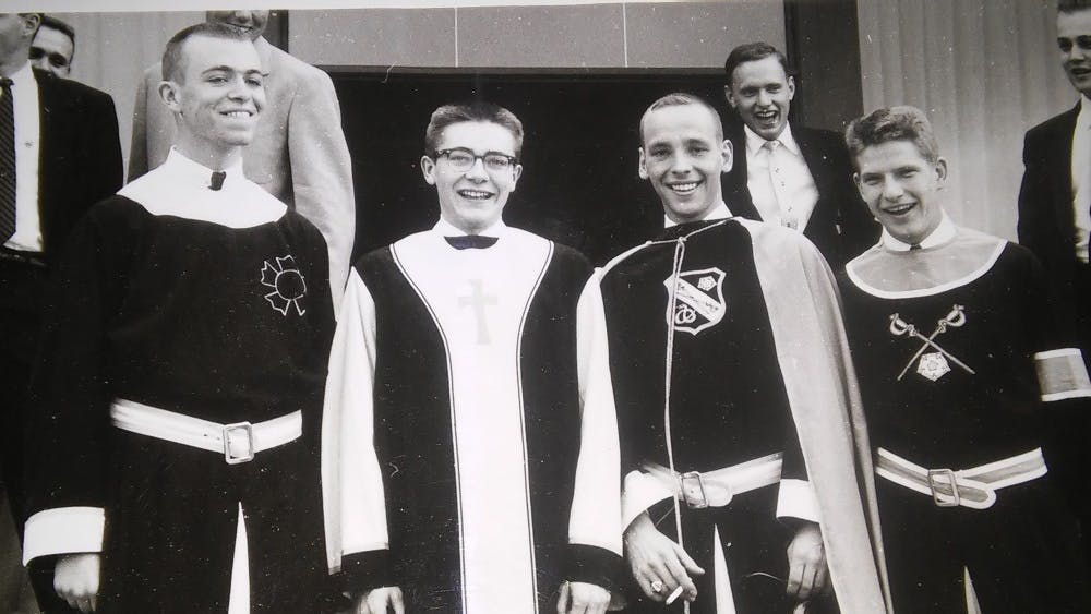 Officers stand left to right in 1956: Ralph Wible, Harold Leininger II, Jim Soukup and Neil Morehead. Leininger says he thinks the IU chapter of Sigma Nu no longer has the same mission and vision as when he was a member.