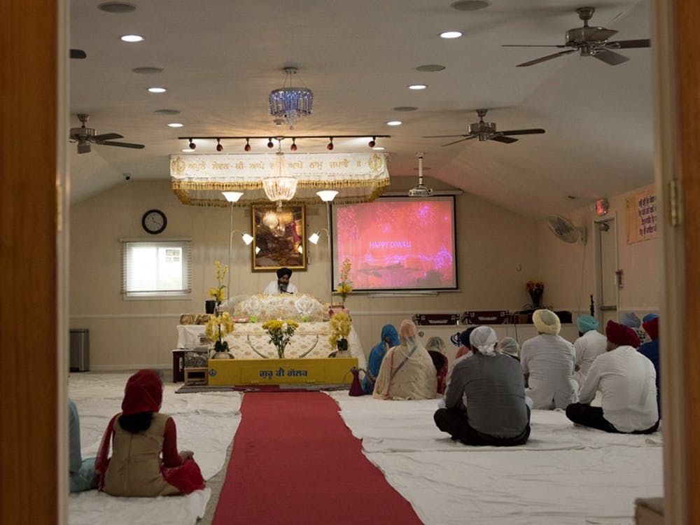 Sikhism practitioners in Fishers, Ind. attending a weekly religious ceremony where words from the Guru Granth Sahib are read. The Holy Book contains passages from the Quran and from the Old Testament.