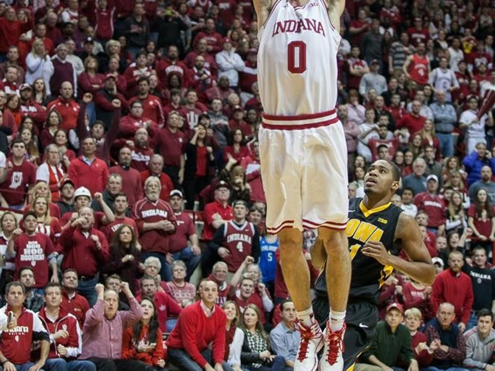 Forward Will Sheehey dunks against Iowa on Thursday at Assembly Hall. Sheehey led Indiana with 30 points in the win.