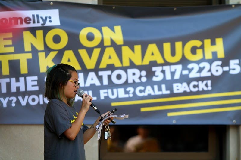Abby Ang speaks at the protest against Brett Kavanaugh's Supreme Court nomination Sept. 20 at the Monroe County Courthouse. Ang is the spokesperson for Indivisible Bloomington and 9th District.