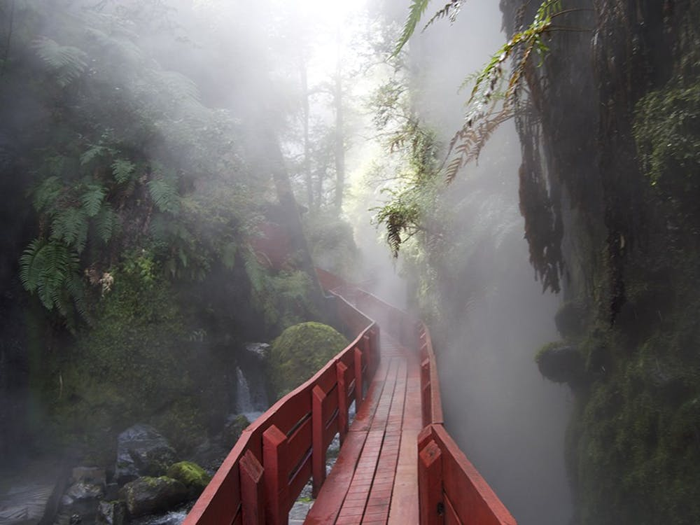 A red, wooden walkway leads visitors to the different pools the Hot Springs has to offer, and at the end of the walkway a waterfall greets viewers eyes. Though the pools are hot, the waterfall and small river that run through the area are ice cold.