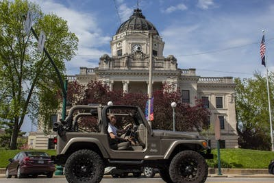 A car drives April 22 through downtown Bloomington. The first 32 proposed amendments to Bloomington's Transportation Plan were released more than a week ago.