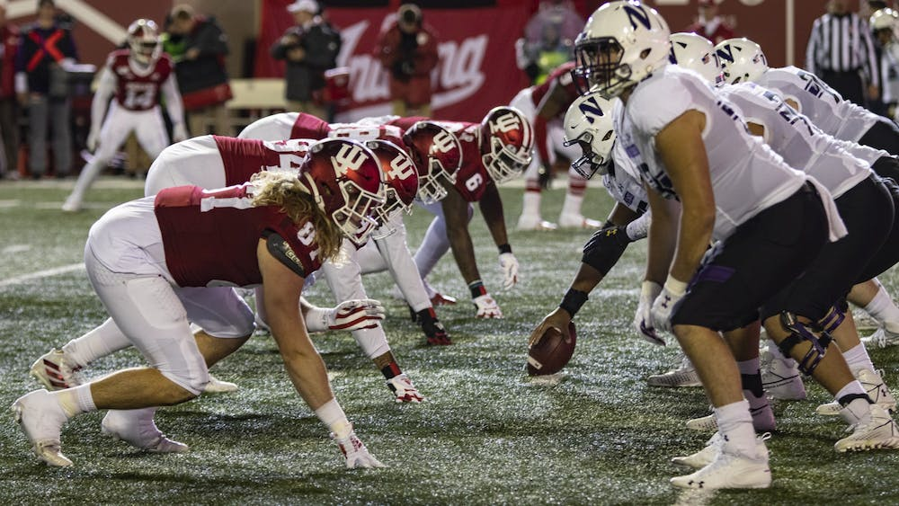 IU's defensive linemen prepare for Northwestern to snap the ball Nov. 2 at Memorial Stadium. IU will play Penn State on Nov. 16 at University Park, Pennsylvania.
