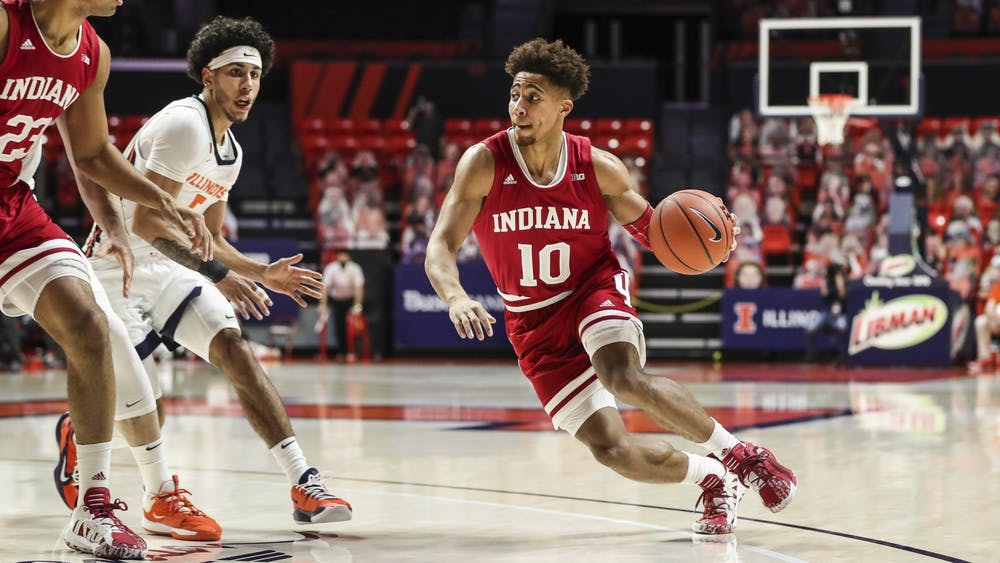 IU junior guard Rob Phinisee dribbles the ball Dec. 26, 2020, at the State Farm Center in Champaign, Illinois. IU will play Illinois at 9 p.m. Tuesday.