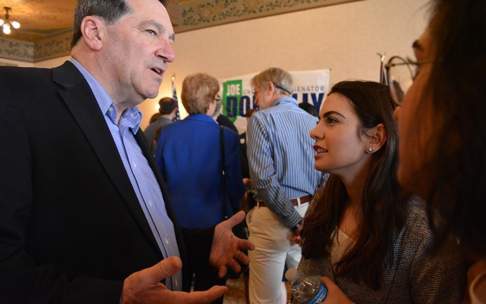 <p>IU senior&nbsp;Dana Khabbaz speaks with Sen. Joe Donnelly, D-Indiana, after his speech. Donnelley came to Bloomington on Saturday to begin fundraising for his 2018 election.</p>