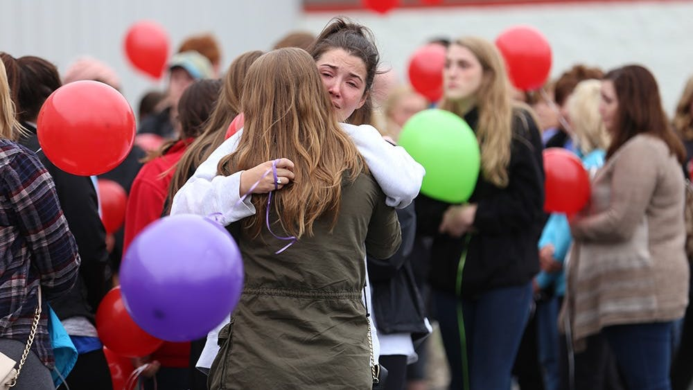 Hundreds gather to mourn the loss of Hannah Wilson, IU senior murdered Friday morning, outside Indiana Elite Cheer & Tumbling in Noblesville, Ind. on Saturday afternoon. Wilson, a Fishers, Ind. native who used to cheer at Indiana Elite, was a psychology major and a sister in the Gamma Phi Beta sorority at IU.