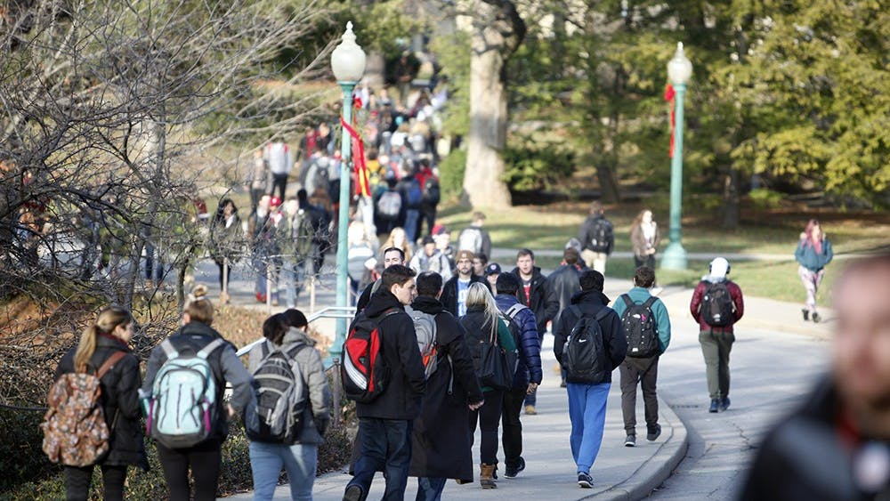 IU students walk on campus between classes in 2016. Despite more full-time students who take 15 or more credit hours, overall University enrollment is declining, said John Applegate, executive vice president for university academic affairs, at the October 2017 Board of Trustees meeting.