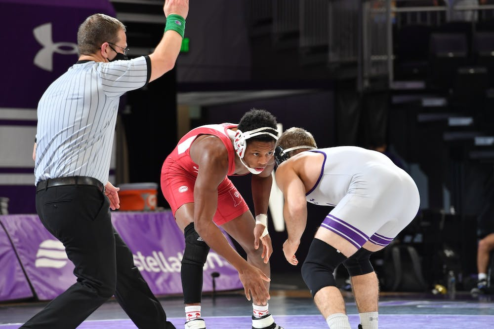 Sophomore DJ Washington stares down Northwestern redshirt freshman Troy Fisher during their match Jan. 30. Washington was named Big Ten Wrestler of the Week after pinning Fisher and defeating No. 5 redshirt freshman Carter Starocci from Penn State on Saturday.