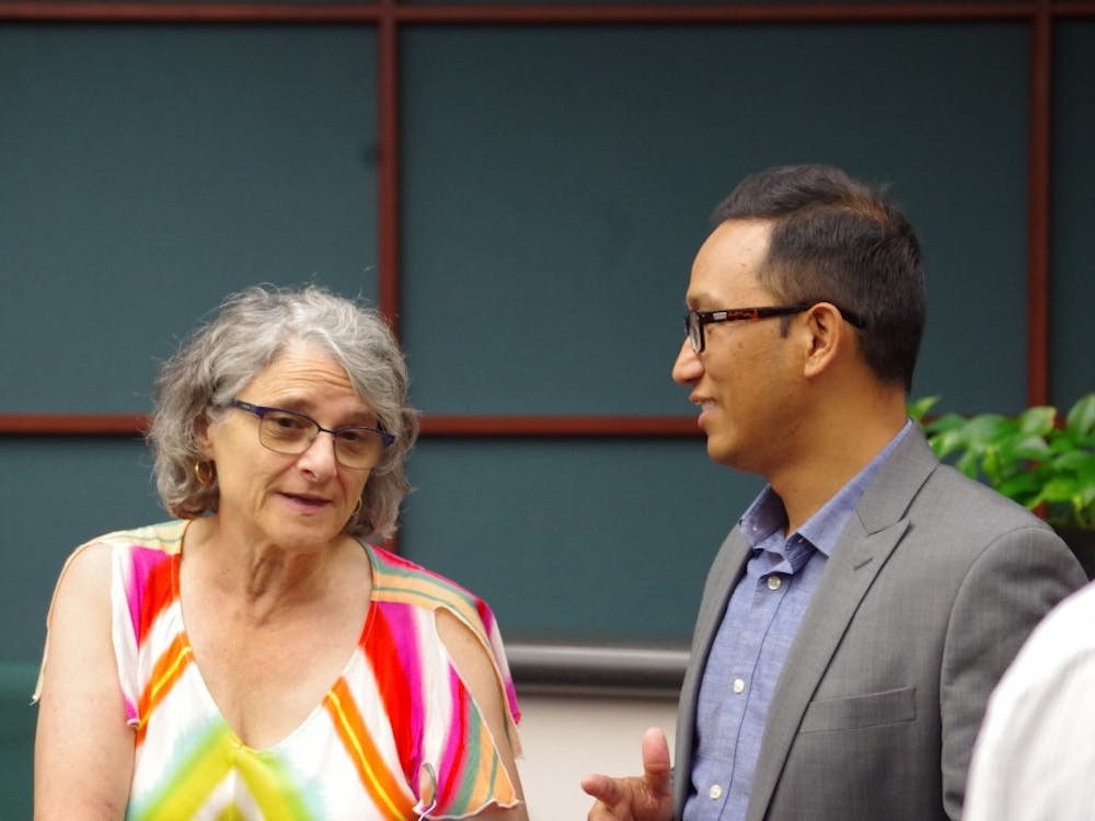 Sagar Onta, right, is the engineering director for Toole Design Group. He fielded questions Thursday about the nature of the city's new transportation plan he designed, which called for changes to Kirkwood Avenue and other major streets.