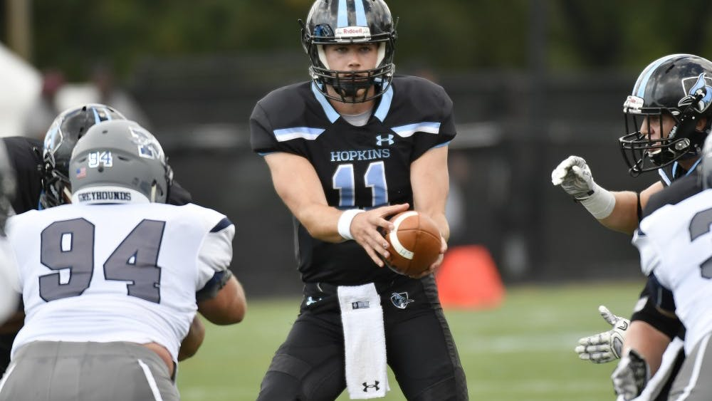HOPKINSSPORTS.COM  Junior quarterback David Tammaro helps team to dominant victory against Dickinson Red Devils.