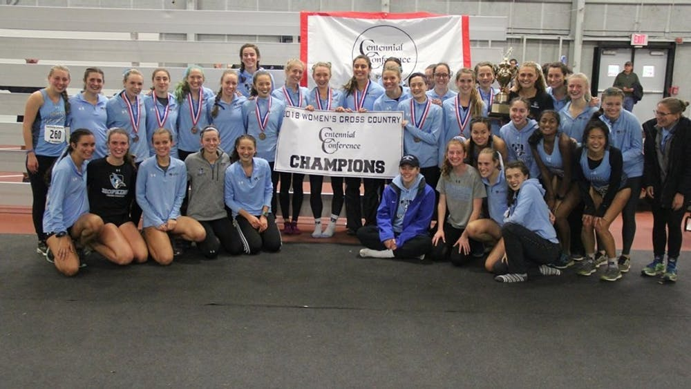 HOPKINSSPORTS.COM The women's cross country team secured a historic 15-point victory.