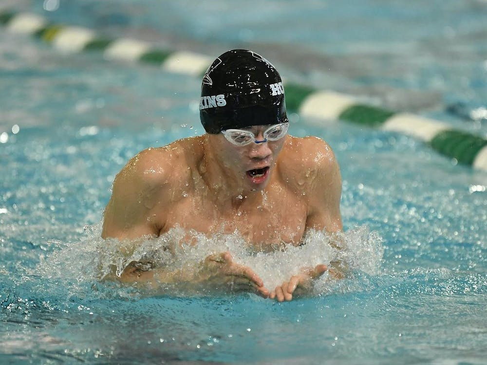 COURTESY OF HOPKINSSPORTS.COM Senior Max Chen won big in dual meet against Towson University and the U.S. Naval Academy.