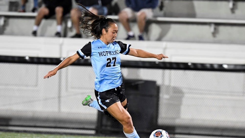 HOPKINSSPORTS.COM Senior Kristen Hori scored the game winning goal against Swarthmore.