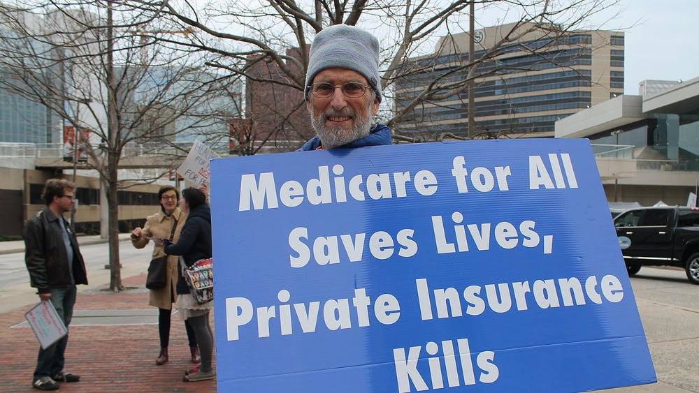 Elvert Barnes/CC BY-SA 2.0 A 2018 rally at the Baltimore Convention Center demanding Medicare for All.