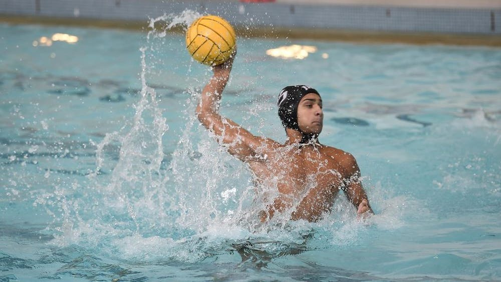 HOPKINSSPORTS.COM Water polo has been struggling this season, but the team is still determined to play hard.
