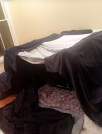 COURTESY OF ASTHA BERRY Make the mess in your living room seem purposeful: Build a blanket fort.