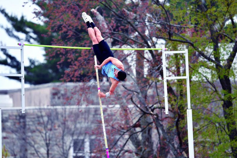 HOPKINSSPORTS.COM Senior Benjamin Huang took fifth in pole vault with a 4.45-meter vault.