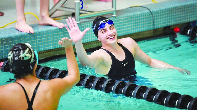 HOPKINSSPORTS.COM The swim teams broke multiple pool records at the Blue Jay Invitational.