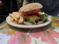 COURTESY OF Jerry Wu The deliciously decadent bacon cheeseburger with fries served at The Dizz.