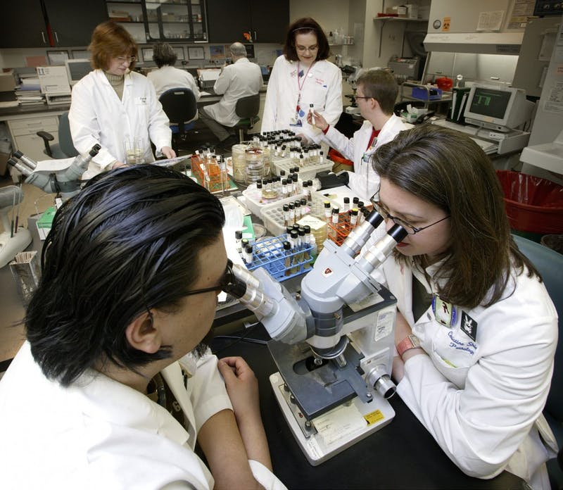 Johns Hopkins University students in a laboratory. (Johns Hopkins University Photo)