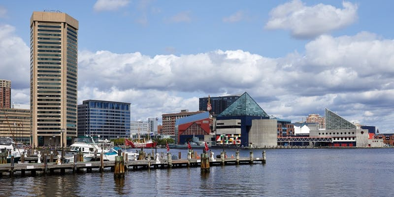 Xiaokui Qin/ CC BY-SA 4.0 The Inner Harbor is a popular tourist spot filled with restaurants and shops.