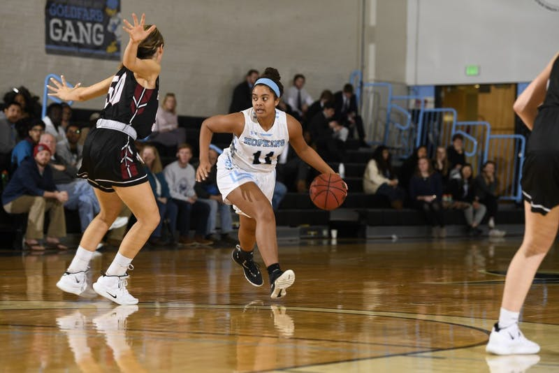 HOPKINSSPORTS.COM Sophomore forward Elise Moore scored six straight points in the first half.