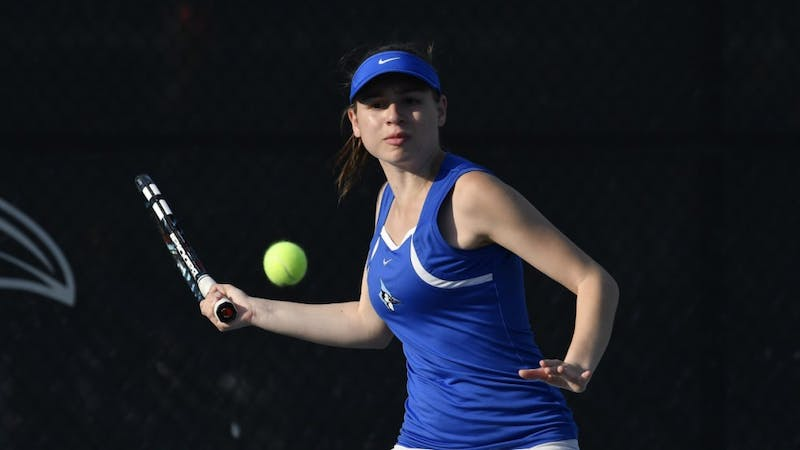 COURTESY OF HOPKINSSPORTS.COM  Junior Chrissy Simon helped earn the women's tennis team's victory over the Dickinson Red Devils with her impressive doubles performance.