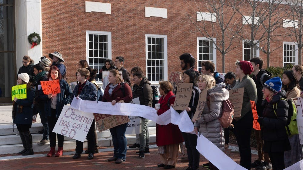 Activists gathered on the steps of MSE Library where they shared their experiences reporting sexual misconduct and assault to the Office of Institutional Equity.