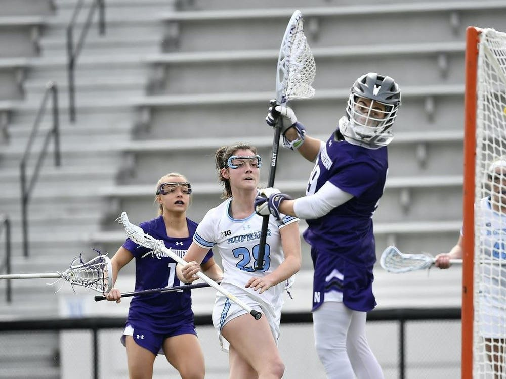 COURTESY OF HOPKINSSPORTS.COM Freshman midfielder Abbey Hurlbrink scored a hat-trick in the first game of the series.