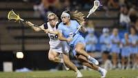 HOPKINSSPORTS.COM Junior attack Maggie Schneidereith earns Big Ten Offensive honors.
