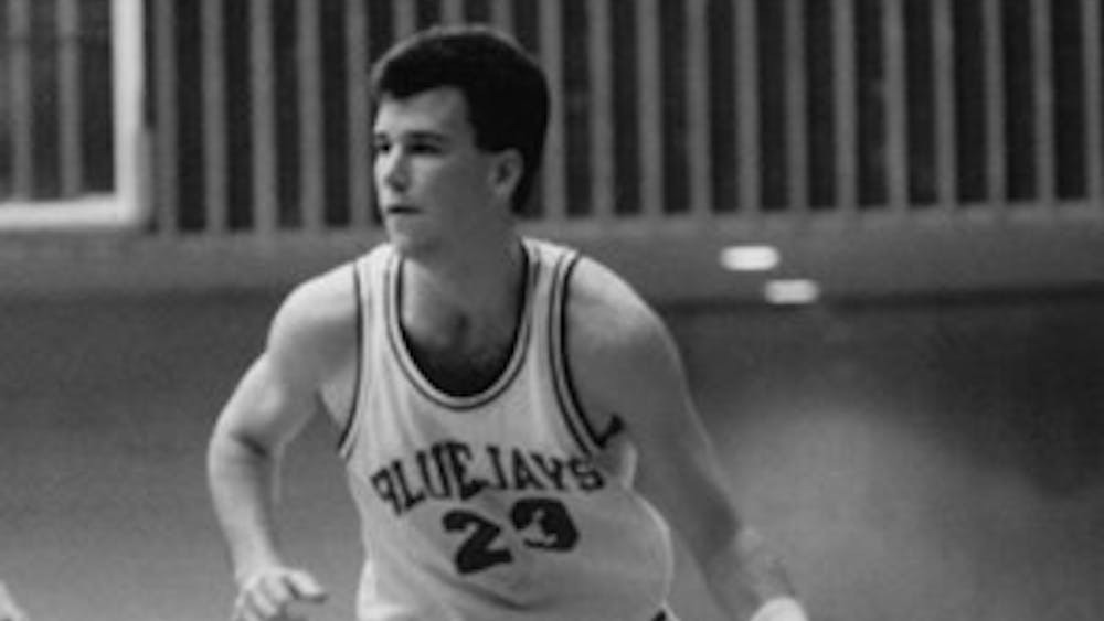 COURTESY OF HOPKINSSPORTS.COM Andy Enfield, current head coach for USC men's basketball and former Hopkins player, is the reason why Furey puts USC in the Final Eight for his NCAA basketball bracket to this day.
