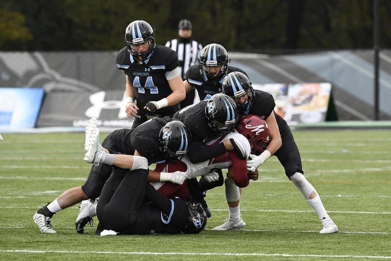 HOPKINSSPORTS.COM The Hopkins defense forced six turnovers against Muhlenberg.